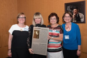 CHW Ottawa Co-Presidents Sophie Frenkel and Linda Senzilet presented CHW National Executive Director Alina Ianson with a poster about CHW founder, Lillian Freiman.